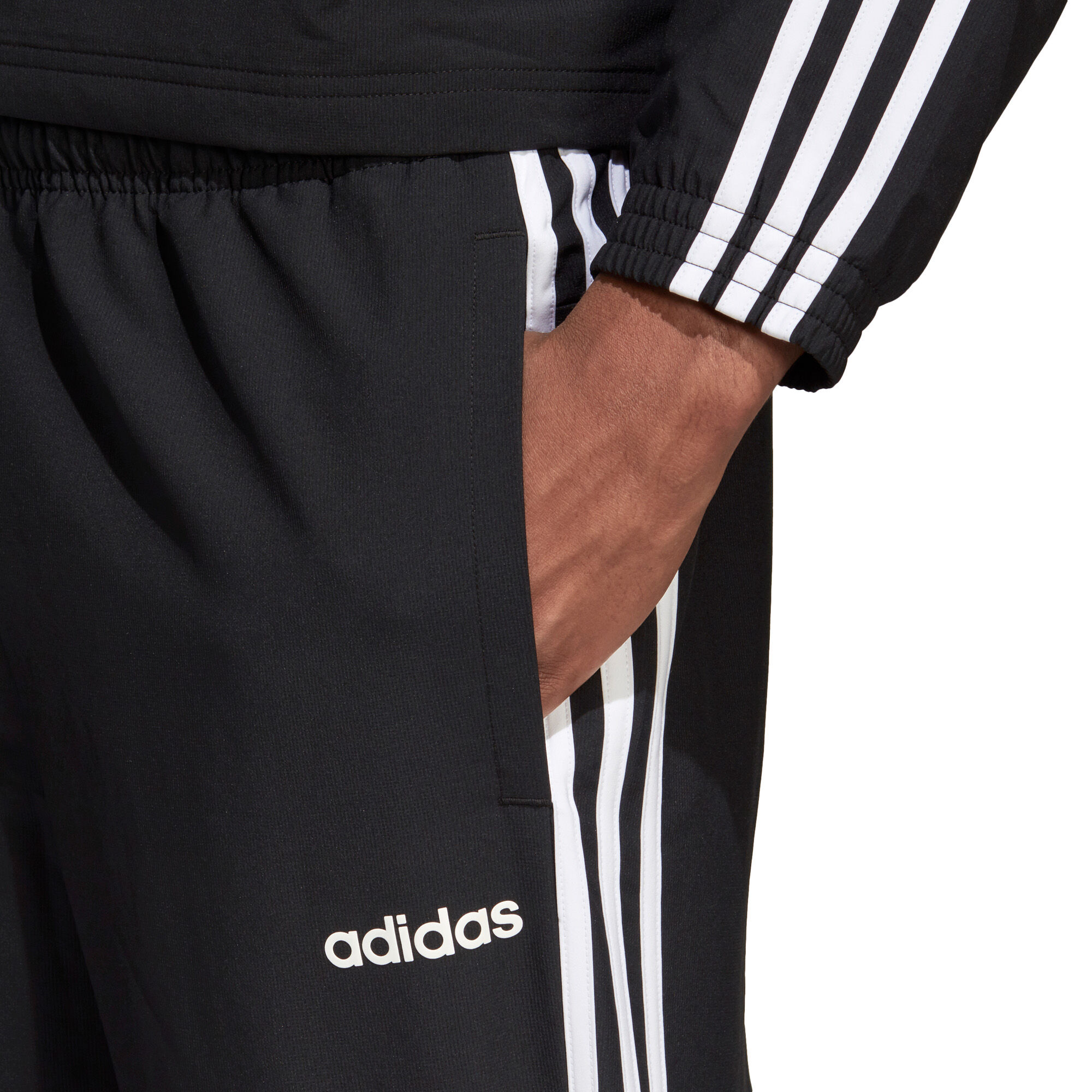 adidas · Essentials 3 Stripes Wind treningsbukse herre