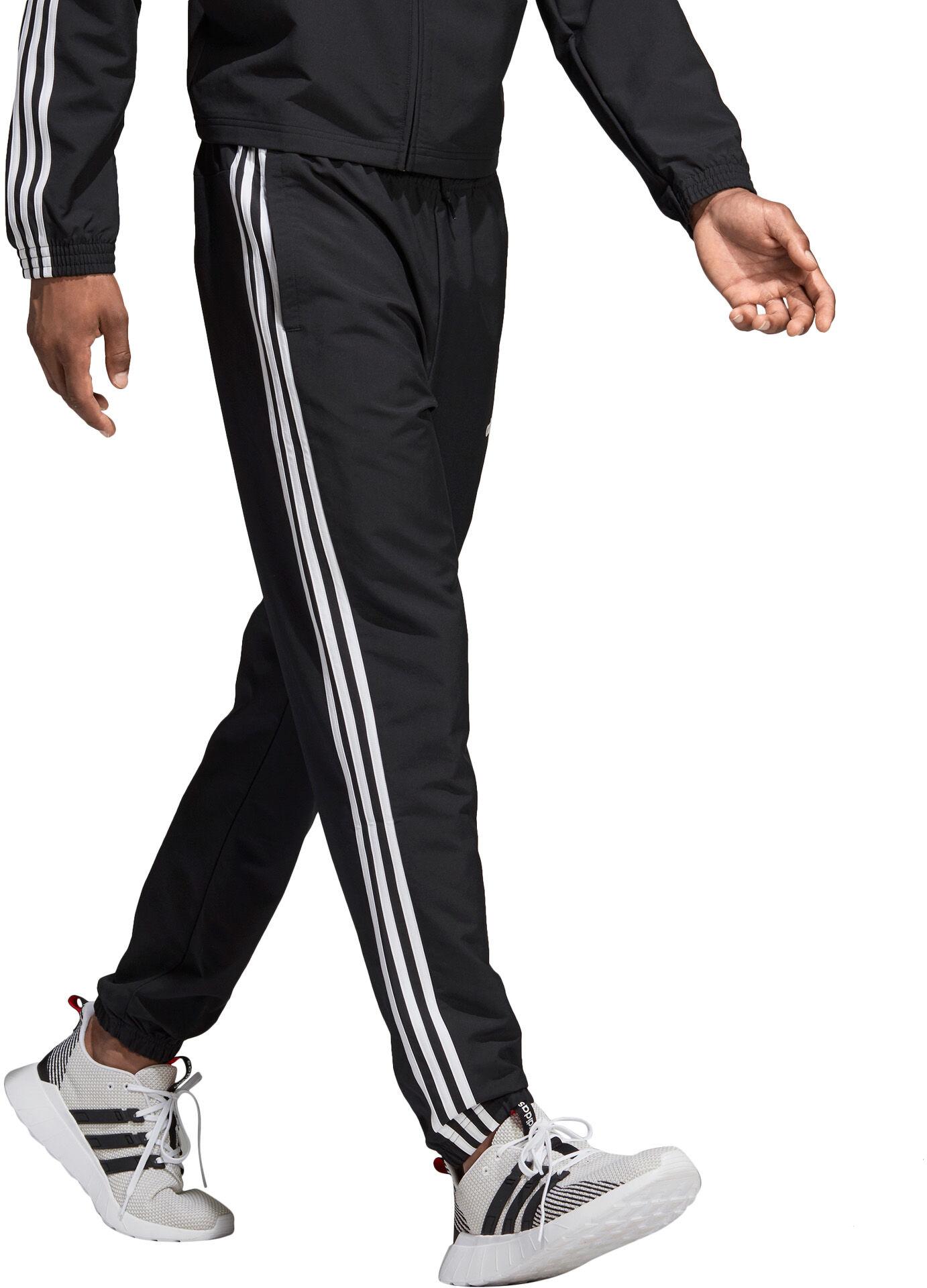 adidas · Essentials 3 Stripes Wind treningsbukse herre